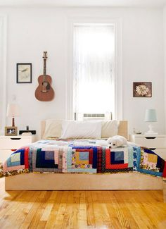 also love this modern-farmhousey look. clean wood and graphic quilts.