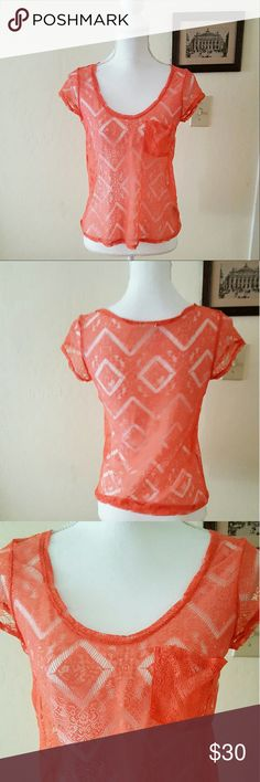 Urban Outfitters Kimchi Blue Delicate Coral Top Urban Outfitters Kimchi Blue Delicate Coral Top. Size XS. Chevron cutout Top. Has loose parts, but that is part of the pattern.  Length 22 in Chest Flatlay 15 in  Ships 1-3 days Urban Outfitters Tops Tees - Short Sleeve