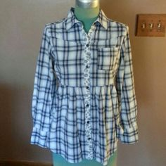 """Free People Shirt Black and White cotton plaid design with floral design down the front button up front has front pockets gathering around back waist button up sleeves also is 28""""long Free People Tops"""