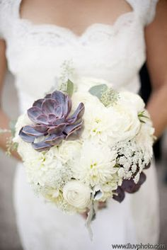 The bridal bouquet will be a clutch bouquet of ivory stock flowers, fresh lavender, ivory spray roses, Queen Anne's lace, gray purple succulents, ivory astilbe, and white sweet peas wrapped in ivory ribbon with the stems showing.