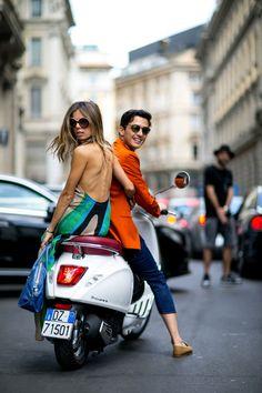 vespa chic. #EricaPelosini hitching a ride in Milan.