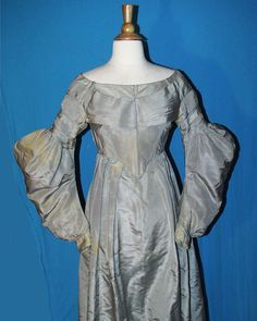 """c. 1835 silk dress, recently de-accessioned from the Rochester Historical society in NY; back hook & loop closure, cartridge pleated in back; bodice lined with polished cotton, skirt unlined, 5 whale bone baleen stays; underarm discoloration; bust: 32""""; waist: 26"""""""