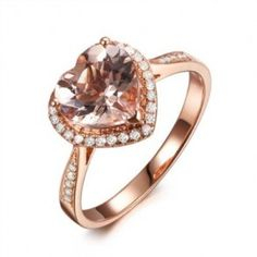 Heart Shape Morganite Diamond Engagement Ring - A ring of beauty comes this incredible Heart Shape Morganite Diamond Engagement Ring that features a Morganite gemstone in a prong setting & stamped in 14k Rose Gold. It's flanked with halo style White Round Brilliant cut accent stones that surrounds the center stone on the edge. The accent diamonds are H in color, SI in clarity & the total gem weight of the ring is 1.55 carats. All of the diamonds are 100% natural. #unusualengagementrings