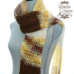 A personal favorite from my Etsy shop https://www.etsy.com/listing/265603524/knit-net-scarf-brown-aran-yellow-honey