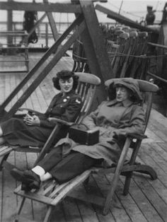 Two WACs in chairs aboard ship, circa 1950 - The Betty H. Carter Women Veterans Historical Project - UNCG University Archives