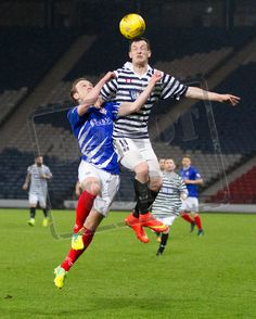 Queen's Park's David Galt wins the header during the SPFL League One play off game between Queen's Park and Cowdenbeath.