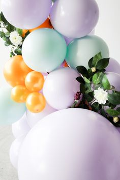 Pastel coloured balloon arch in lilac, mint and gold with green and flower decorations. Flower Decorations, Wedding Decorations, Wedding Balloons, Balloon Arch, Lilac, Wedding Inspiration, Pastel, Mint, Flowers