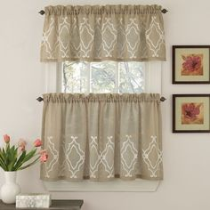 Update the look of your home decor with the look and feel of luxury linen with these semi-opaque window ensemble pieces. It features a chain stitched embroidered geometric motif.