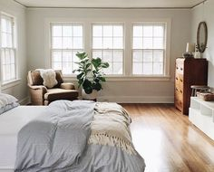 clean and simple little bedroom with blue stripes.