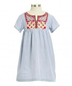 A simple, short sleeved embroidered at the top dress,