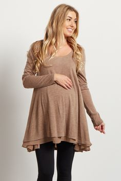 A basic knit maternity top for the perfect fall to winter wardrobe. Chiffon lined, creating a flared layer look this top gives you a flattering, stylishly modern piece to pair with a maternity skinny jean day or night.