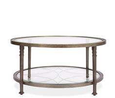 COFFEE TABLE LIVING ROOM:  GLASS WITH METAL BASE IN CLEAN LINES WITH SLIGHT CURVES Ramona Coffee Table - Constructed of metal and glass, the Ramona round tables feature tempered glass tops and one fixed shelf. Stocked in an antique water based finish. Fixed