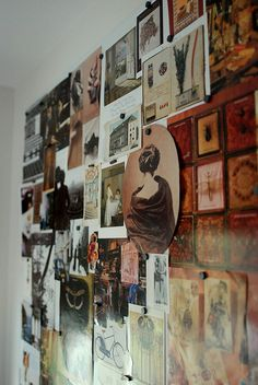 Artist studio or office display with antique images. (Inspiration board/mood board/picture wall.)