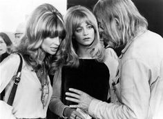 """Julie Christie with Goldie Hawn on the set of """"Shampoo"""", 1975. Director Hal Ashby is the bearded longhair on the right."""