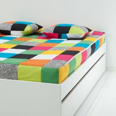 Avaroom bed with storage underneath & cover.