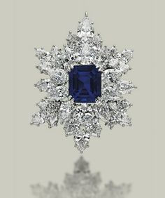A SAPPHIRE AND DIAMOND BROOCH-PENDANT, BY HARRY WINSTON