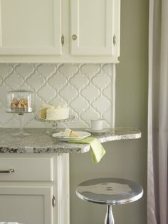Well, I've been on the hunt for something other than white for my back splash tile. I was sure that I could never love another tile as much as I loved my white arabesques in the last kitchen. I still had some pieces of that white tile (the movers accidentally took the extras when they packed us up--...