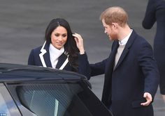 Harry and Meghan get into a car following their visit to Millennium Point on International...