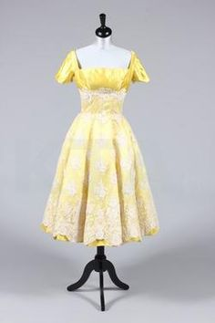 Evening dress designed and worn by Alma Cogan, late 1950's Bust is 97cm/38in, waist is 71cm/28in, about a size 16 UK/12 US. Click to go to the absentee bidding page.  This Kerry Taylor auction will end October 16th at 2:00 PM GMT (9:00 AM EST).  You will need to register to bid ahead of time.