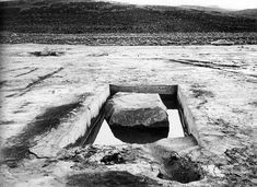 Michael Heizer    Displaced/Replaced Mass, 1969. Silver Springs,  Nevada. Granite boulders in concrete lined pits.