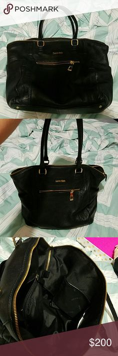 Calvin Klein large leather purse. Calvin Klein large leather purse. Has been used. In excellent condition besides peeling handle can be seen in last picture. Come with dust bag. Clean every where else. Has zipper pocket in front. Back magnet pocket. Large zipper for purse. On the front inside two pockets and on the back inside a zipper pocket. Two pockets on the side. Bags Shoulder Bags