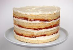 a fluffy, moist tender coconut milk white cake (made with plenty of butter and cake flour); filled with kaya, kaya is the asian version of dulce de leche made with coconut milk; cream cheese buttercream; strawberry preserves and sweet shredded coconut