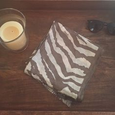 NWOT zebra striped coach scarf Absolutely adorable scarf that has never been used! Great to pair with a cute sweater or even a leather jacket and a pair of jeans!  I love to offer bundle discounts! No trades. Please use the offer button to submit offers! Coach Accessories Scarves & Wraps