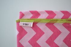 Chevron baby girl swaddler. Blanket size: Size 31 by 40 inches. Colors- Pink on pink with green edging.