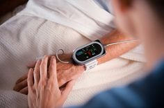 ViSi Mobile system straps to a patient's wrist, lets doctors track vitals with asmartphone