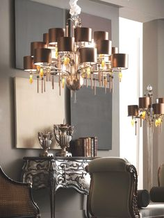 """Guenda-R Collection Handmade metal chain tassels, Silver/Brown Color with strass  Brown glass flames led lighted crystal rock """"E"""" logo Swarovski elements®.  Simil leather Cocco Copper Shades #eurolampart #light #lighting #chandelier #luxurylight #luxurylife #homecollection  www.eurolampart.it"""