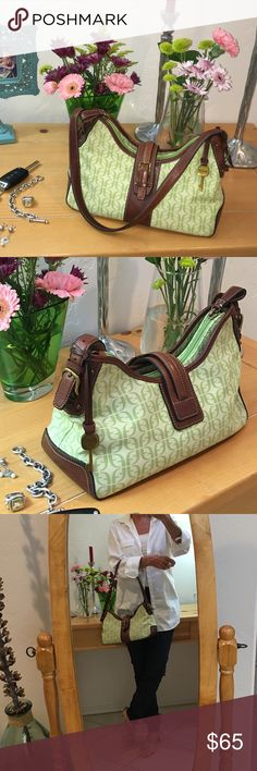 """🚨FLASH SALE🚨 A great mint, lime green color to add to your look for the day.... Refreshing and cool... Looks brand-new...canvas with leather strap, bottom and trim...love the key..width 13"""" length 5 1/2"""" strap 24"""" what a great size it will allow you to fit everything you need in there and it also has a side pocket. Fossil Bags Shoulder Bags"""