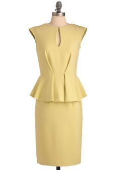 Limoncello-yellow dress garnished with a keyhole neckline, cap sleeves, and a feminine peplum