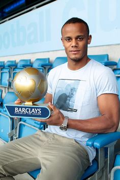 Manchester City's Vincent Kompany with his Player of the Season Award for 2011/12