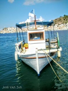 Greece.... Fishing boat Galatas, overlooking Poros, a small Island in the southern part of the Saronic Gulf