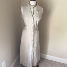 Khaki Linen Maxi-Dress Super cute linen blend maxi-dress with peephole cut-out on the back. Dress buttons all the way done and has tab buttons at the waist . 55% linen blend , 45% rayon. Ultra Dresses Maxi
