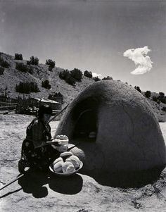 'Maria Martinez (famous Native American potter) baking bread - Rio Grande' by Laura Gilpin, 1946