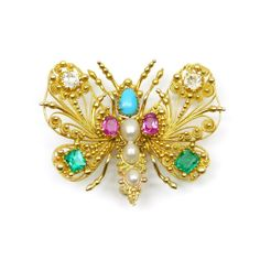 Early 19th century gold and gem set cannetille work butterfly brooch, English c.1820,  formed of open gold scrollwork set with diamond, emerald and ruby wing 'markings', a turquoise to the head and three graduated pearls along the body