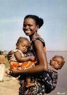 Africa Young mother with twins. published by Hoa-qui