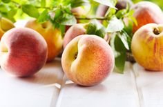 Combine peaches, pears, grapes and cherries for canning fruit cocktail at home.data-pin-do=