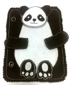 Build a Panda add on quiet book page. children can learn head, feet, and arms. Buy more than one page and mix the pieces up. Would you like to put together your own busy book? All of our 5X 7 quiet book pages are interchangeable, just send us a convo and we will put together a listing and quote you a price.  Perfect activity felt busy book page to take on the road.  Each page is made of felt with machine embroidered details and backed with another piece of felt. Pocket on the back will hold…