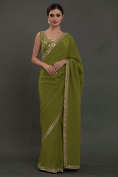 From our Wedding and Bridal Collection, this is a Burgundy pure crepe saree and blouse with intricate exquisite silvery gold gota patti hand embroidery. The embroidered work adorns the saree borders inches wide. Saree Blouse Patterns, Saree Blouse Designs, Saris, Satin Saree, Pure Georgette Sarees, Handloom Saree, Gota Patti Saree, Drape Sarees, Green Saree