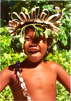 An adorable boy wearing traditional headwear from one of our favourite Pacific spots- Kiribati