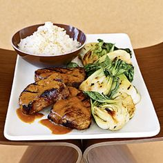 Grill Pork chops indoors and serve with bok choy and a warm orange sauce. Bok choy looks like white celery with wide, dark green leaves.
