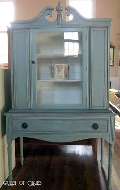Annie Sloan Chalk Paint in Duck Egg Blue, with Old Ochre on the detail, then I did a dark wax wash, with my wax mixed with mineral spirits. Queen of Chairs: June 2012