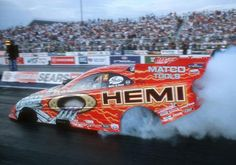 After winning the event three straight years in Top Fuel (1998-2000), Gary Scelzi added a St. Louis Funny Car crown in 2004.