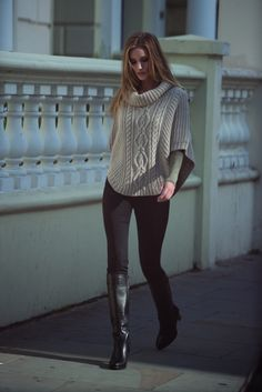 sweater poncho + leggings + tall leather boots.