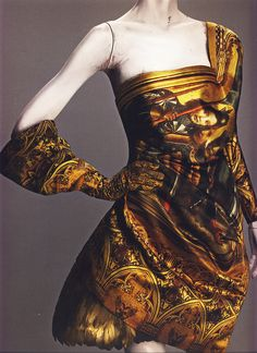 Alexander McQueen Autumn/Winter 2010-11 Ensemble Dress and glove of printed silk; underskirt of duck feathers painted gold Photographed by Sølve Sundsbø for Alexander McQueen: Savage Beauty
