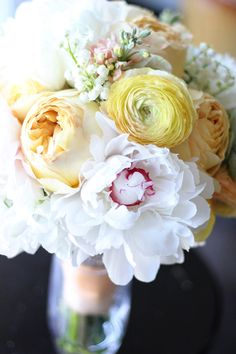 Bouquet by Floret Cadet (www.floretcadet.com) - Carmel Antike Garden Roses, Festiva Max Peonies, Lily of the Valley, Peachy yellow Ranunculus, Peach Stock, White Sweet Peas, White Anemones, and Succulents