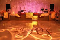 One of the most artistic stage fronts by @MarksGarden with hanging orchids and candles overhead (Venue & Wedding Cake: @fslosangeles   Planner: @internationaleventco   Florals: @marksgarden   Decor: @revelryeventdesigners   Photography: @john_solano_photography   Videography: @vidicamproductions   Band: @westcoastmusicbevhills   Sound: @design.sound   Lighting: @thelightersidela   Table Top Rentals & Chameleon Chairs: @classicparty   Ceremony Chairs: @chiavarichairrentals   Linens…