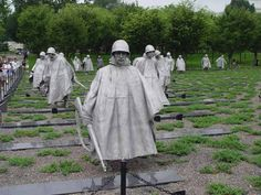Korean War Veterans Memorial, Washington DC. Commemorating those who served in the war, the memorial is 19 stainless steel statues of a squad on patrol, including the Army, Marines, Air Force and Navy and 2 black stone walls sandblasted with pictures of soldiers, equipment and civilians involved in the war.